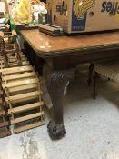 An Edwardian mahogany extending dining table,