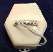 A 9 carat white gold five stone diamond set dress ring, approx 2.