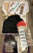 A collection of ostrich modesty fans, embroidered bookmarks, various handbags,