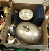 A box containing two plated graduated food domes, a pewter quaich,