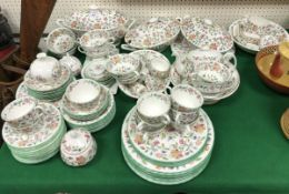 "A large collection of Minton ""Haddon Hall"" floral decorated dinner wares,"