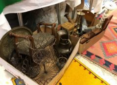 Two boxes containing various decorative items including small stool, embossed copper water jug,