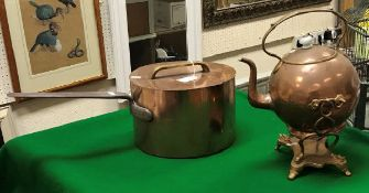A Victorian copper saucepan with lid (possibly later) and copper and brass spirit kettle (burner