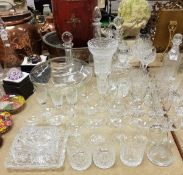 Four various decanters to include a Dartington decanter together with various cut wine glasses and