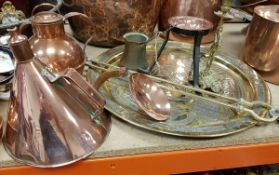 A collection of brass and copper ware to include three cream jugs,