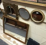 Two gilt framed wall mirrors,