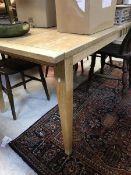 A modern elm plank topped farmhouse style kitchen table