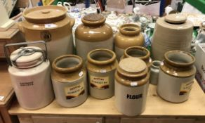 A collection of eleven various stoneware jars, including William Powell and Son pottery of Bristol,
