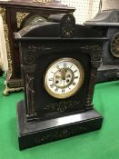 A late Victorian black marble cased mantel clock of architectural form,