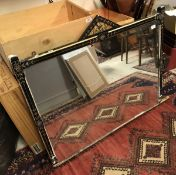 A Victorian painted and ebonised framed over mantel mirror in the aesthetic taste (for restoration)
