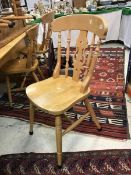A collection of eight beech slat back kitchen chairs