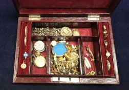 """A burgundy leather jewellery box initialled """"MG"""" to top containing assorted jewellery to include"""