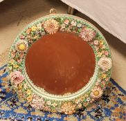 A Continental floral encrusted circular framed wall mirror in the Meissen style