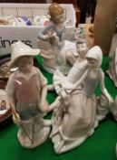 "A collection of four Lladro figures including ""Young Girl Picking Petals from a Flower"","