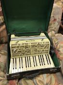 A Hohner Verdi II simulated mother of pearl veneered piano accordion with case