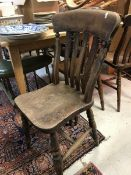 A set of five Victorian slat back kitchen chairs and a similar stick back chair