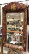 A modern Toleware style chinoiserie decorated cushion framed wall mirror