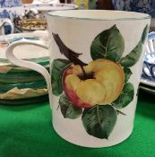 "A Wemyss Pottery ""Apple"" decorated mug,"