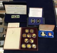 A collection of cased silver medals, each with hand-enamelled decoration by Carpenter & Howlett,