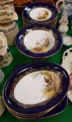 A collection of Royal Worcester game decorated dessert plates including circular plates and serving