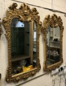 A pair of gilt framed mirrors with cheru