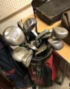 A golf bag and contents of Spalding Prog