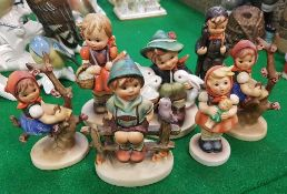 A collection of seven Geobel Hummell figures of children various