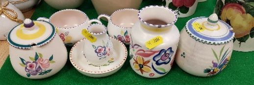 Seven pieces of Poole pottery including preserve pots, small dish,