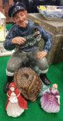 "A Royal Doulton figure ""The Lobster Man"" (HN2317) together with two V."
