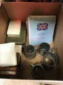 A box containing various pewter tankards, an Aston Martin owners club registar,