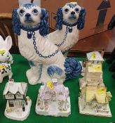 "A pair of Staffordshire blue and white glazed pottery spaniel figures inscribed to base ""Hand"