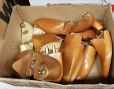 A box containing five pairs of wooden shoe forms (2 x size 11, 2 x size 11.
