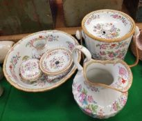 A late Victorian Cauldon china six piece floral transfer decorated toilet set