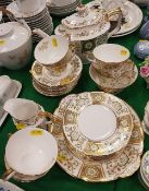 "A modern Royal Crown Derby ""Green Derby"" panel decorated tea set comprising teapot, eight cups,"