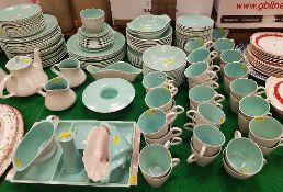 A large collection of Poole twin-tone dinner wares in grey and mint, to include dinner plates,