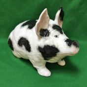 "A large Wemyss Pottery ""Pig"" black and white sponge decorated with well painted eyes, circa 1890,"