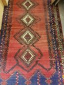 A Persian rug with five repeating lozeng