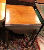 An Edwardian mahogany tea table with fou