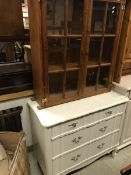 A modern white painted chest of three dr