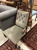 A Victorian walnut framed salon chair wi
