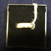 An 18 carat gold band set with three dia