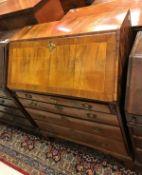 An 18th Century walnut bureau the cross-