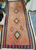 A 20th Century Kelim rug in blue, red, b