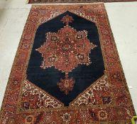 A Persian carpet with centre medallion o