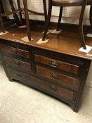 A circa 1900 walnut chest of four short