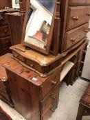 A modern pine kneehole dressing table an