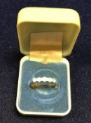An 18 carat gold five stone set diamond