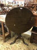 A 19th Century oak tea table, the circul