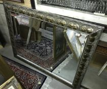 A modern rectangular wall mirror with fo