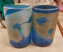 A pair of iridescent blue glass vases in